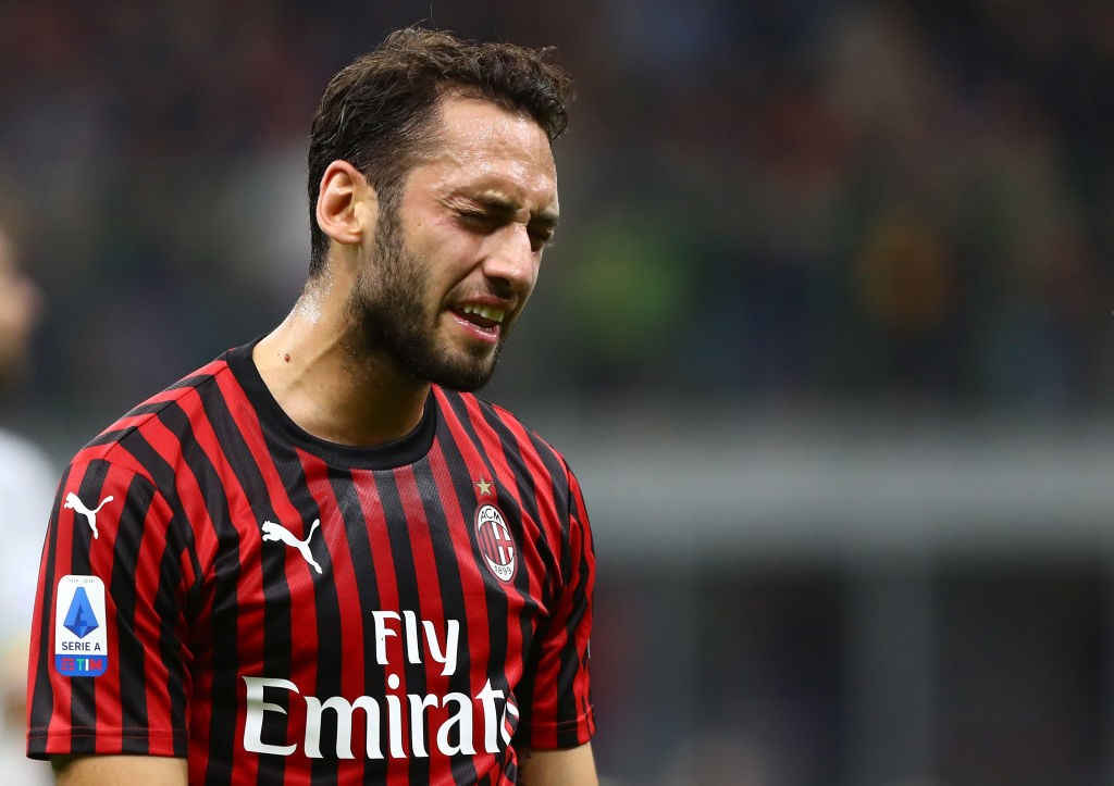 MILAN, ITALY - OCTOBER 20: Hakan Calhanoglu of AC Milan reacts during the Serie A match between AC Milan and US Lecce at Stadio Giuseppe Meazza on October 20, 2019, in Milan, Italy. (Photo by Marco Luzzani/Getty Images)