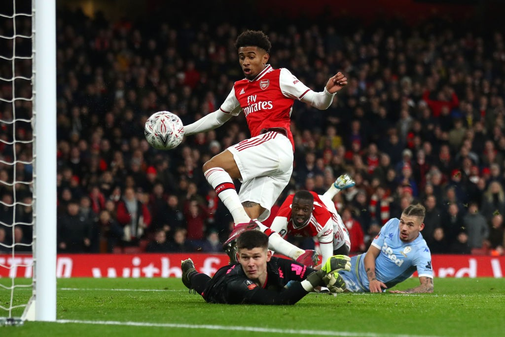 LONDON, ENGLAND - JANUARY 06: Reiss Nelson of Arsenal scores his side's first goal past Illan Meslier of Leeds United during the FA Cup Third Round match between Arsenal FC and Leeds United at the Emirates Stadium on January 06, 2020, in London, England. (Photo by Julian Finney/Getty Images)