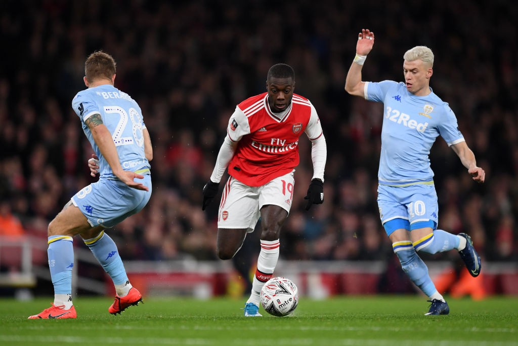 LONDON, ENGLAND - JANUARY 06: Nicolas Pepe of Arsenal takes on Gaetano Berardi and Ezgjan Alioski of Leeds United during the FA Cup Third Round match between Arsenal FC and Leeds United at the Emirates Stadium on January 06, 2020, in London, England. (Photo by Shaun Botterill/Getty Images)