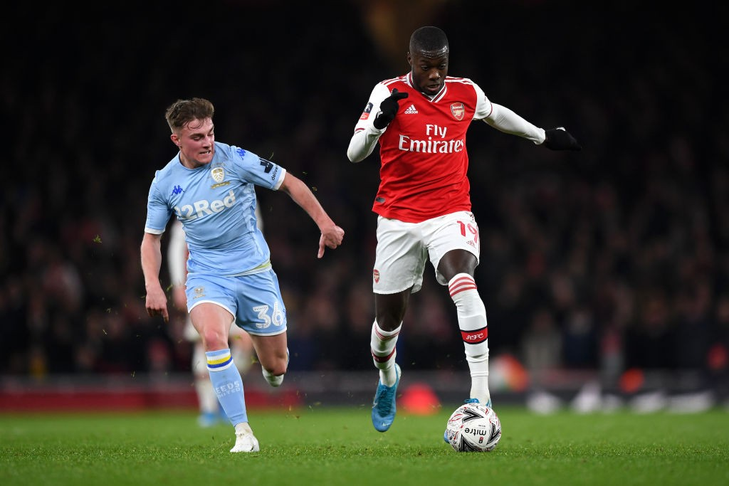 LONDON, ENGLAND - JANUARY 06: Nicolas Pepe of Arsenal makes a break past Robbie Gotts of Leeds United during the FA Cup Third Round match between Arsenal FC and Leeds United at the Emirates Stadium on January 06, 2020, in London, England. (Photo by Shaun Botterill/Getty Images)