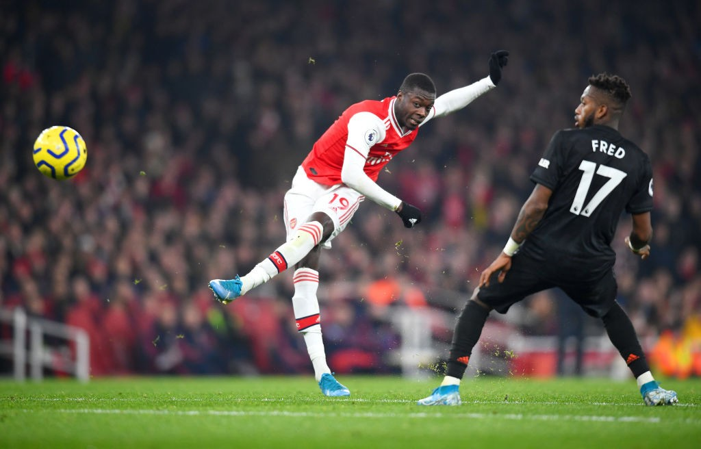 LONDON, ENGLAND - JANUARY 01: Nicolas Pepe of Arsenal shoots as Fred of Manchester United attempts to block during the Premier League match between Arsenal FC and Manchester United at Emirates Stadium on January 01, 2020, in London, United Kingdom. (Photo by Clive Mason/Getty Images)