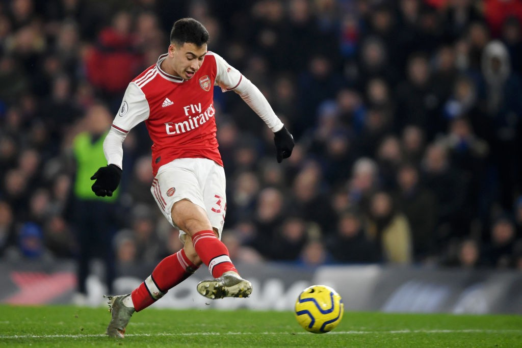 LONDON, ENGLAND - JANUARY 21: Gabriel Martinelli of Arsenal scores his team's first goal during the Premier League match between Chelsea FC and Arsenal FC at Stamford Bridge on January 21, 2020, in London, United Kingdom. (Photo by Mike Hewitt/Getty Images)