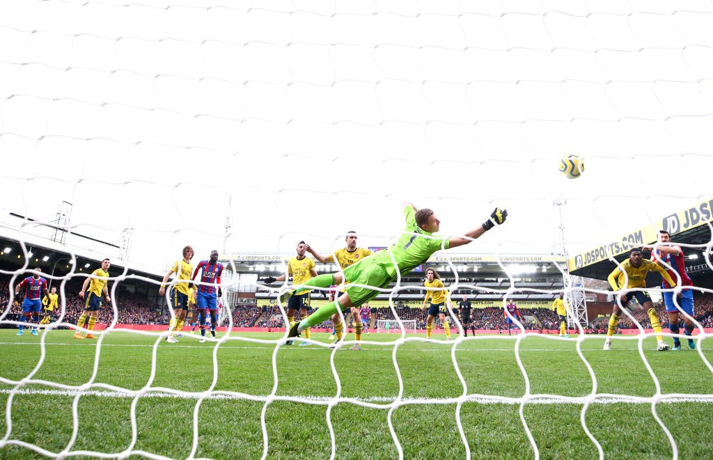 LONDON, ENGLAND - JANUARY 11: Bernd Leno of Arsenal reaches for the ball as Jordan Ayew of Crystal Palace scores his team's first goal during the Premier League match between Crystal Palace and Arsenal FC at Selhurst Park on January 11, 2020, in London, United Kingdom. (Photo by Dan Istitene/Getty Images)
