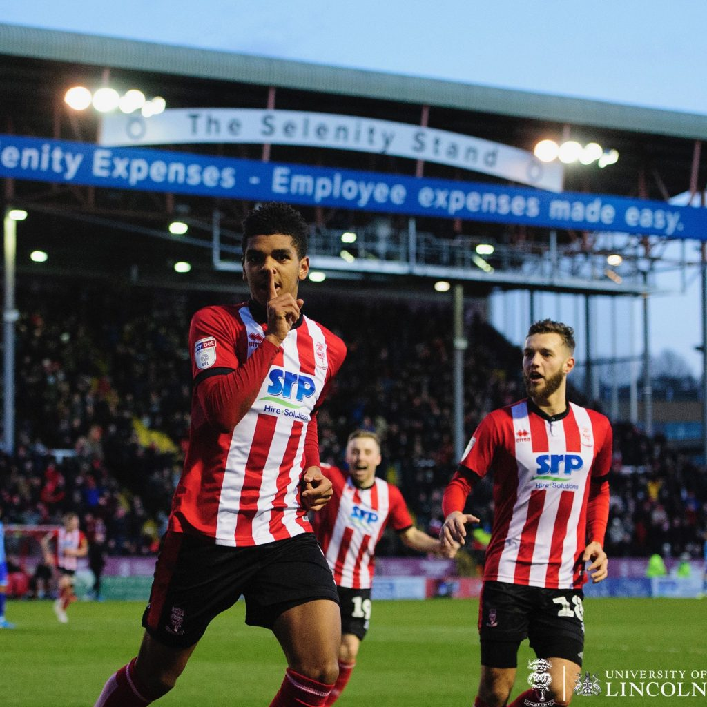Tyreece John-Jules celebrating scoring for Lincoln City against Blackpool (Photo via Twitter)