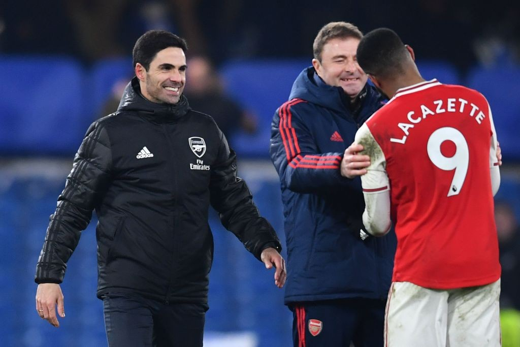Arsenal's Spanish head coach Mikel Arteta (L) reacts with Arsenal's French striker Alexandre Lacazette after the English Premier League football match between Chelsea and Arsenal at Stamford Bridge in London on January 21, 2020. - The match ended in a draw at 2-2. (Photo by Ben STANSALL / AFP)