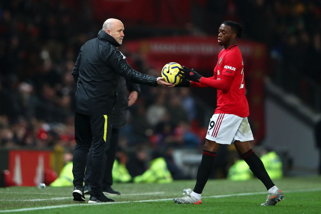 MANCHESTER, ENGLAND - DECEMBER 26: Mike Phelan, Assistant Manager of Manchester United passes the ball to Aaron Wan-Bissaka of Manchester United during the Premier League match between Manchester United and Newcastle United at Old Trafford on December 26, 2019, in Manchester, United Kingdom. (Photo by Clive Brunskill/Getty Images)