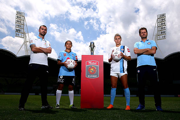 MELBOURNE, AUSTRALIA - JANUARY 30: (L- R) Sydney FC head coach Dan Barrett and captain Teresa Polias and Melbourne City FC head coach Joe Montemurro and captain Steph Catley pose during a W-League Grand Final media opportunity at AAMI Park on January 30, 2016 in Melbourne, Australia. (Photo by Michael Dodge/Getty Images)