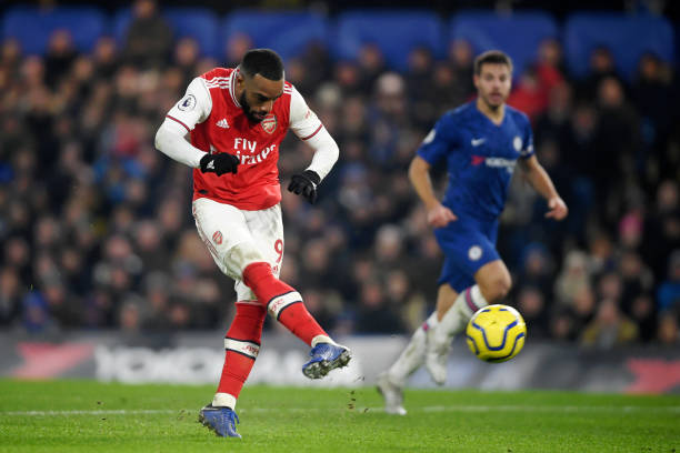 LONDON, ENGLAND - JANUARY 21: Alexandre Lacazette of Arsenal scores a goal which is later disallowed due to being offside during the Premier League match between Chelsea FC and Arsenal FC at Stamford Bridge on January 21, 2020 in London, United Kingdom. (Photo by Mike Hewitt/Getty Images)