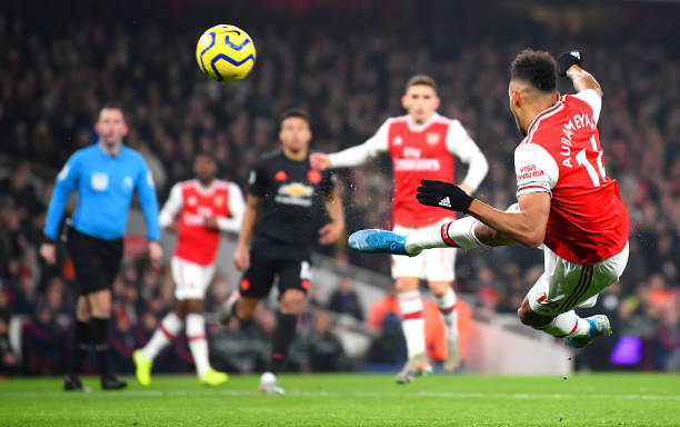 LONDON, ENGLAND - JANUARY 01: Pierre-Emerick Aubameyang of Arsenal volleys during the Premier League match between Arsenal FC and Manchester United at Emirates Stadium on January 01, 2020 in London, United Kingdom. (Photo by Clive Mason/Getty Images)