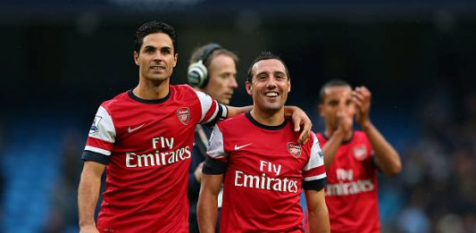 MANCHESTER, ENGLAND - SEPTEMBER 23: Mikel Arteta and Santi Cazorla of Arsenal at the finsl whistle during the Barclays Premier League match between Manchester City and Arsenal at Etihad Stadium on September 23, 2012 in Manchester, England. (Photo by Alex Livesey/Getty Images)