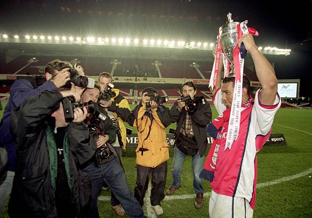 12 May 2000:  Jermaine Pennant of Arsenal celebrates with the trophy after the Times FA Youth Cup Final second leg against Coventry City at Highbury in London.  Arsenal won the match 2-0.  Mandatory Credit: Gary M Prior/Allsport