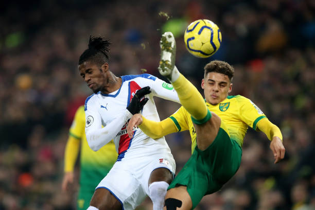 NORWICH, ENGLAND - JANUARY 01: Wilfried Zaha of Crystal Palace in action with Max Aarons of Norwich City during the Premier League match between Norwich City and Crystal Palace at Carrow Road on January 1, 2020 in Norwich, United Kingdom. (Photo by Marc Atkins/Getty Images)