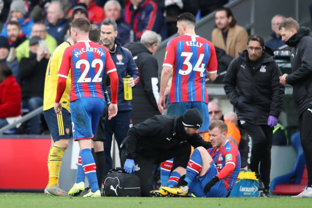 LONDON, ENGLAND - JANUARY 11: Max Meyer of Crystal Palace receives medical treatment after being fouled by Pierre-Emerick Aubameyang of Arsenal, who was later shown a red card following a VAR decision during the Premier League match between Crystal Palace and Arsenal FC at Selhurst Park on January 11, 2020 in London, United Kingdom. (Photo by Alex Pantling/Getty Images)