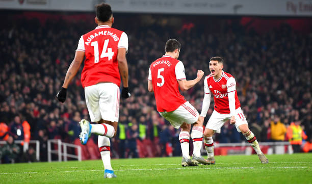 LONDON, ENGLAND - JANUARY 01: Sokratis Papastathopoulos of Arsenal celebrates with Lucas Torreira of Arsenal after scoring his team's second goal during the Premier League match between Arsenal FC and Manchester United at Emirates Stadium on January 01, 2020 in London, United Kingdom. (Photo by Clive Mason/Getty Images)
