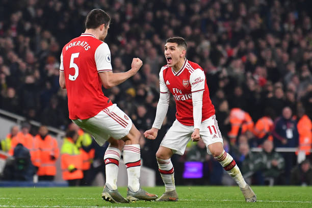 Arsenal's Greek defender Sokratis Papastathopoulos (L) celebrates with Arsenal's Uruguayan midfielder Lucas Torreira (R) after scoring their second goal during the English Premier League football match between Arsenal and Manchester United at the Emirates Stadium in London on January 1, 2020. (Photo by Ben STANSALL / AFP)