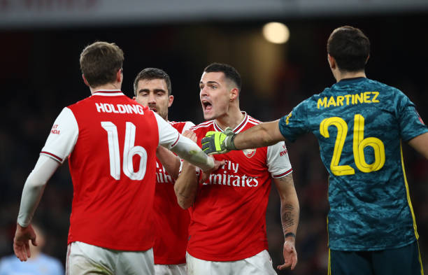 LONDON, ENGLAND - JANUARY 06: Granit Xhaka of Arsenal (c) argues with Rob Holding of Arsenal (L) during the FA Cup Third Round match between Arsenal FC and Leeds United at the Emirates Stadium on January 06, 2020 in London, England. (Photo by Julian Finney/Getty Images)