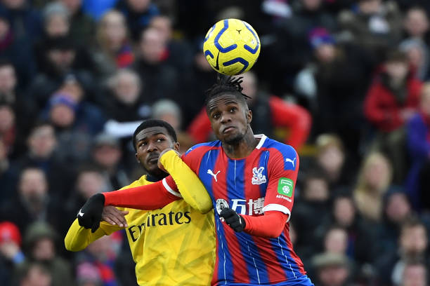 Arsenal's English midfielder Ainsley Maitland-Niles (L) vies with Crystal Palace's Ivorian striker Wilfried Zaha during the English Premier League football match between Crystal Palace and Arsenal at Selhurst Park in south London on January 11, 2020. (Photo by DANIEL LEAL-OLIVAS / AFP)