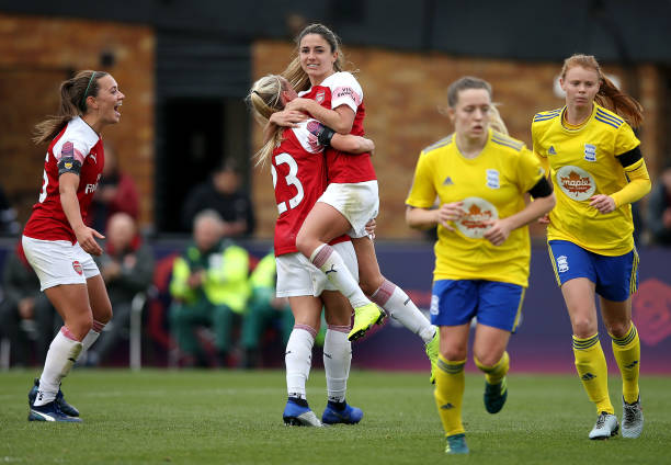Danielle Van De Donk of Arsenal celebrates scoring her sides second goal from a penalty with Beth Mead during the WSL match between Arsenal Women and Birmingham Ladies at Meadow Park on November 4, 2018 in Borehamwood, England.