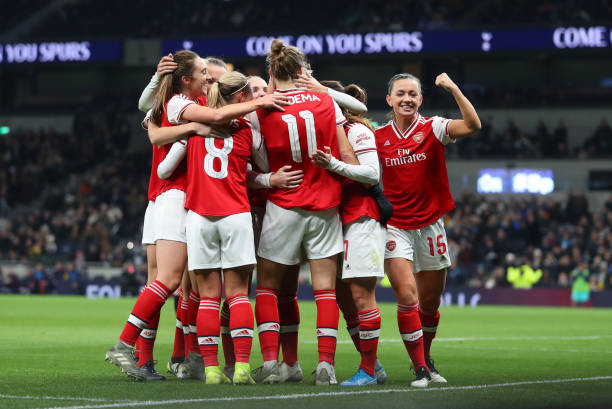 Katie McCabe of Arsenal celebrates with the team after Vivianne Miedema of Arsenal scores her sides second goal during the Barclays FA Women's Super League match between Tottenham Hotspur and Arsenal at Tottenham Hotspur Stadium on November 17, 2019 in London, United Kingdom.