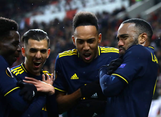 Alexandre Lacazette of Arsenal celebrates with teammates Bukayo Saka, Dani Ceballos and Pierre-Emerick Aubameyang after scoring his teams first goal during the UEFA Europa League round of 32 first leg match between Olympiacos FC and Arsenal FC at Karaiskakis Stadium on February 20, 2020 in Piraeus, Greece.