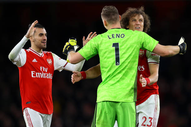 Dani Ceballos, David Luiz and Bernd Leno of Arsenal celebrate victory during the Premier League match between Arsenal FC and Everton FC at Emirates Stadium on February 23, 2020 in London, United Kingdom.
