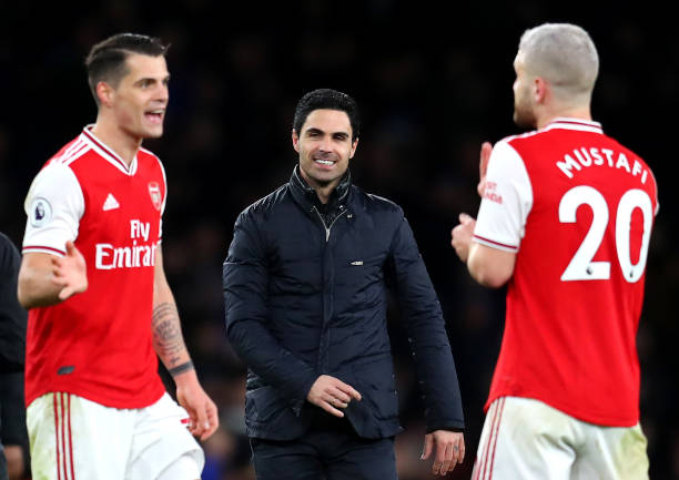Mikel Arteta, Granit Xhaka and Shkodran Mustafi of Arsenal celebrate during the Premier League match between Arsenal FC and Everton FC at Emirates Stadium on February 23, 2020 in London, United Kingdom.