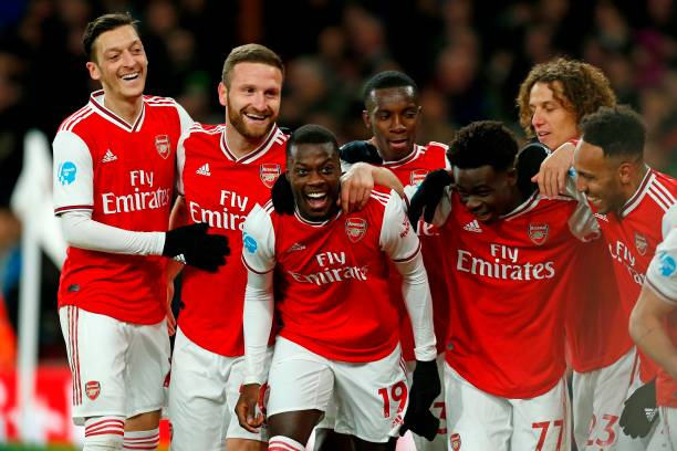 Arsenal's French-born Ivorian midfielder Nicolas Pepe (C) celebrates with teammates after scoring their second goal during the English Premier League football match between Arsenal and Newcastle United at the Emirates Stadium in London on February 16, 2020.