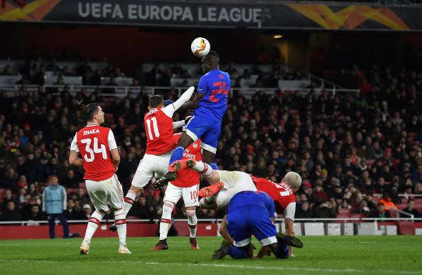 Ousseynou Ba of Olympiacos FC heads wide during the UEFA Europa League round of 32 second leg match between Arsenal FC and Olympiacos FC at Emirates Stadium on February 27, 2020 in London, United Kingdom.