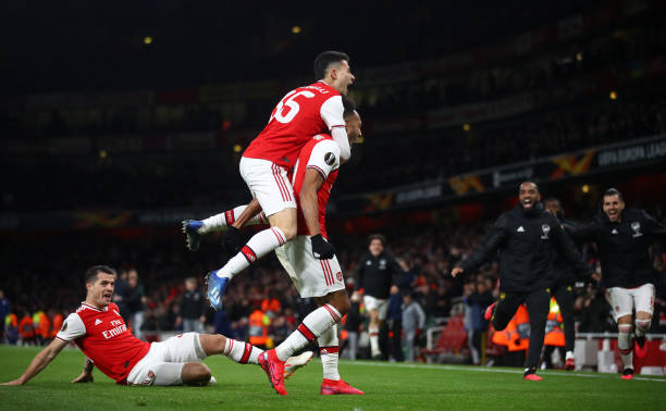 Pierre-Emerick Aubameyang of Arsenal FC celebrates with Gabriel Martinelli after scoring his team's first goal in extra-time during the UEFA Europa League round of 32 second leg match between Arsenal FC and Olympiacos FC at Emirates Stadium on February 27, 2020 in London, United Kingdom.
