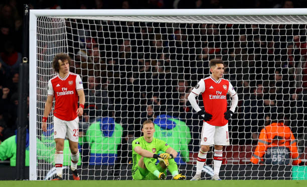David Luiz , Bernd Leno and Lucas Torreira of Arsenal FC look dejected after their side concede their second goal during the UEFA Europa League round of 32 second leg match between Arsenal FC and Olympiacos FC at Emirates Stadium on February 27, 2020 in London, United Kingdom.