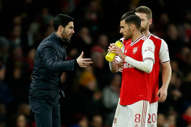 Arsenal's Spanish head coach Mikel Arteta (L) talks with Arsenal's Spanish midfielder Dani Ceballos (2nd R) during the English Premier League football match between Arsenal and Newcastle United at the Emirates Stadium in London on February 16, 2020.