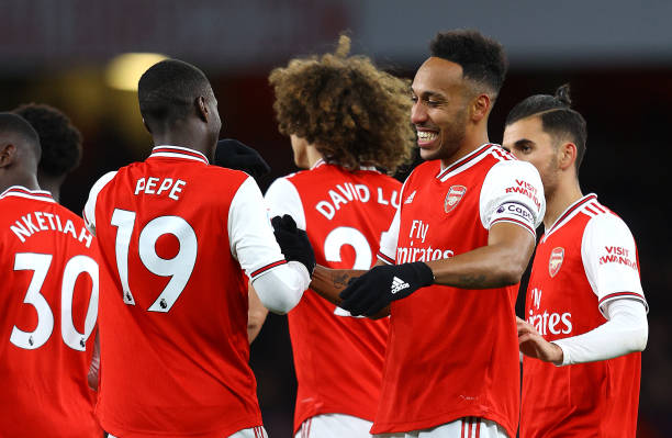 Pierre-Emerick Aubameyang of Arsenal celebrates with Nicolas Pepe after he scores his sides first goal during the Premier League match between Arsenal FC and Newcastle United at Emirates Stadium on February 16, 2020 in London, United Kingdom.