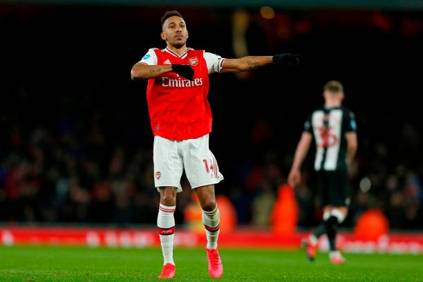 Arsenal's Gabonese striker Pierre-Emerick Aubameyang celebrates after scoring the opening goal of the English Premier League football match between Arsenal and Newcastle United at the Emirates Stadium in London on February 16, 2020.