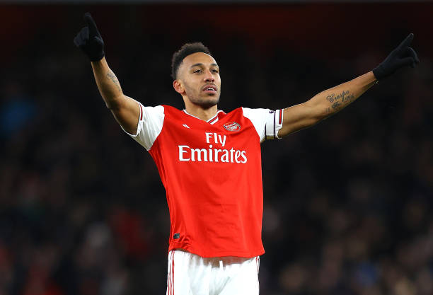 Pierre-Emerick Aubameyang of Arsenal celebrates after he scores his sides first goal during the Premier League match between Arsenal FC and Newcastle United at Emirates Stadium on February 16, 2020 in London, United Kingdom.