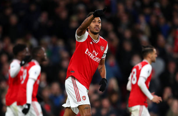 Pierre-Emerick Aubameyang of Arsenal celebrates after scoring his sides third goal during the Premier League match between Arsenal FC and Everton FC at Emirates Stadium on February 23, 2020 in London, United Kingdom.