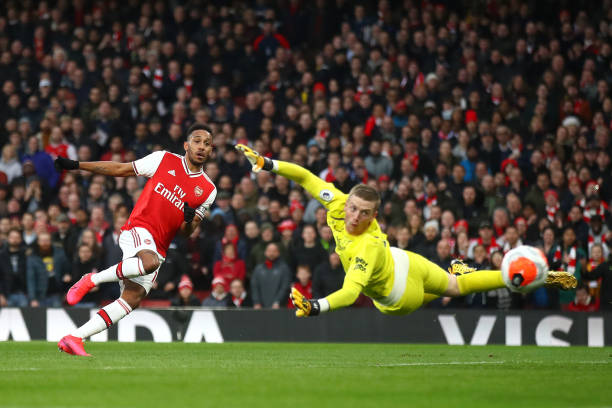 Pierre-Emerick Aubameyang of Arsenal scores his team's second goal past Jordan Pickford of Everton during the Premier League match between Arsenal FC and Everton FC at Emirates Stadium on February 23, 2020 in London, United Kingdom.