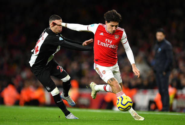 Hector Bellerin of Arsenal takes on Miguel Almiron of Newcastle United during the Premier League match between Arsenal FC and Newcastle United at Emirates Stadium on February 16, 2020 in London, United Kingdom.