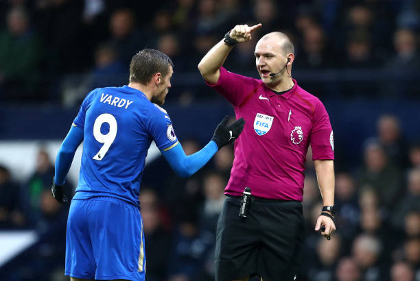 Jamie Vardy of Leicester City speaks with Bobby Madley, Match Referee during the Premier League match between West Bromwich Albion and Leicester City at The Hawthorns on March 10, 2018 in West Bromwich, England.