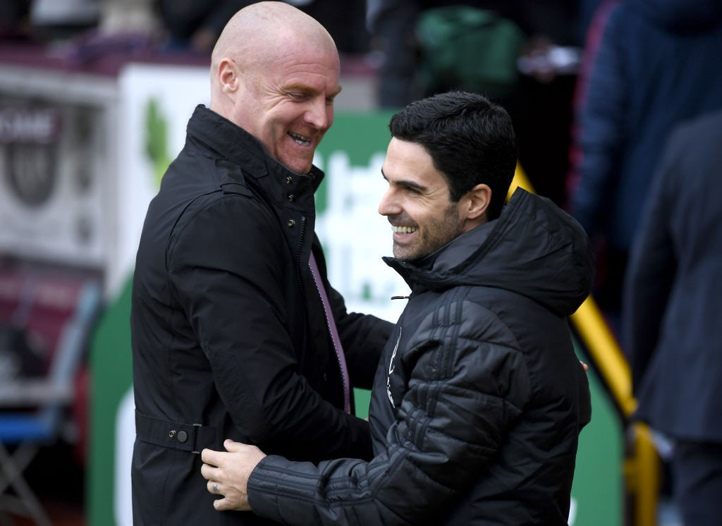 BURNLEY, ENGLAND - FEBRUARY 02: Sean Dyche, Manager of Burnley embraces Mikel Arteta, Manager of Arsenal prior to the Premier League match between Burnley FC and Arsenal FC at Turf Moor on February 02, 2020, in Burnley, United Kingdom. (Photo by Gareth Copley/Getty Images)