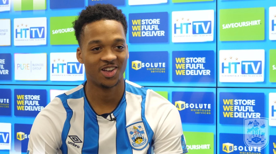Chris Willock during his first interview with Huddersfield Town (Photo via HTAFC.com)