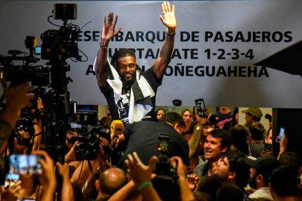 Togo's football player Emmanuel Adebayor waves to Paraguay's Olimpia football fans upon his arrival at the Silvio Pettirossi Airport on February 14, 2020 in Luque, Paraguay.