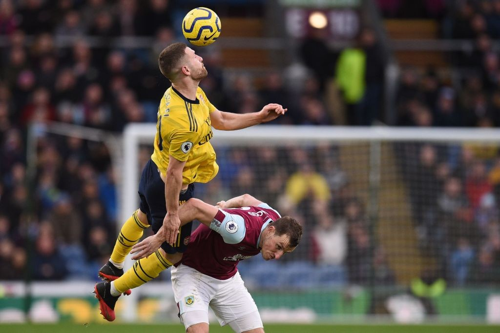 Arsenal's German defender Shkodran Mustafi wins a header from Burnley's New Zealand striker Chris Wood during the English Premier League football match between Burnley and Arsenal at Turf Moor in Burnley, north west England on February 2, 2020. (Photo by Oli SCARFF / AFP)