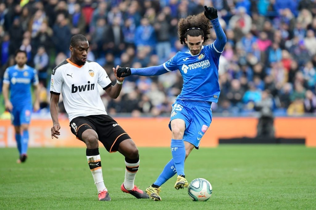 Getafe's Spanish defender Marc Cucurella (R) vies with Valencia's Central African Republic-French midfielder Geoffrey Kondogbia during the Spanish league football match between Getafe CF and Valencia CF at the Col. Alfonso Perez stadium in Getafe on February 8, 2020. (Photo by JAVIER SORIANO / AFP)