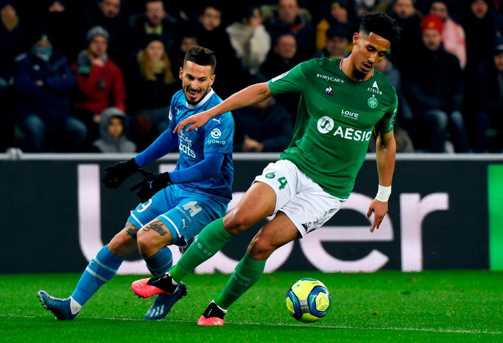 Marseille's Argentinian forward Dario Benedetto (L) vies for the ball with Saint-Etienne's French defender William Saliba (R) during the French L1 football match between Saint-Etienne (ASSE) and Marseille (OM) on February 5, 2020, at the Geoffroy Guichard Stadium in Saint-Etienne, central France. (Photo by JEAN-PHILIPPE KSIAZEK / AFP)