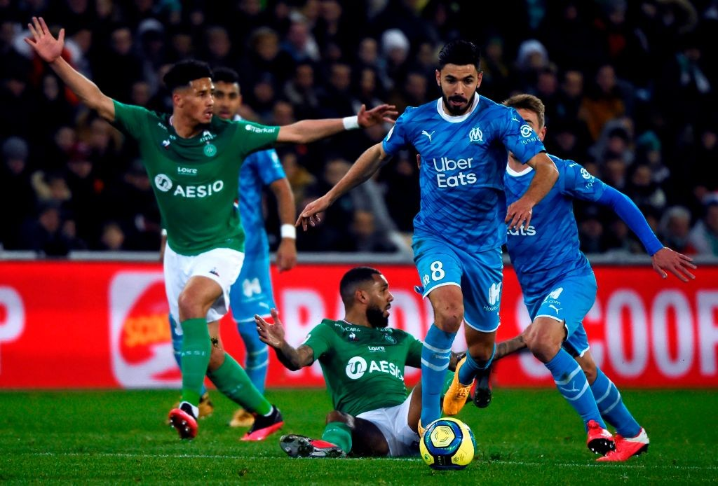 Saint-Etienne's French defender William Saliba (L) and Saint-Etienne's French midfielder Yann Mvila (C) react as Marseille's French midfielder Morgan Sanson (R) runs with the ball during the French L1 football match between Saint-Etienne (ASSE) and Marseille (OM) on February 5, 2020, at the Geoffroy Guichard Stadium in Saint-Etienne, central France. (Photo by JEAN-PHILIPPE KSIAZEK / AFP)