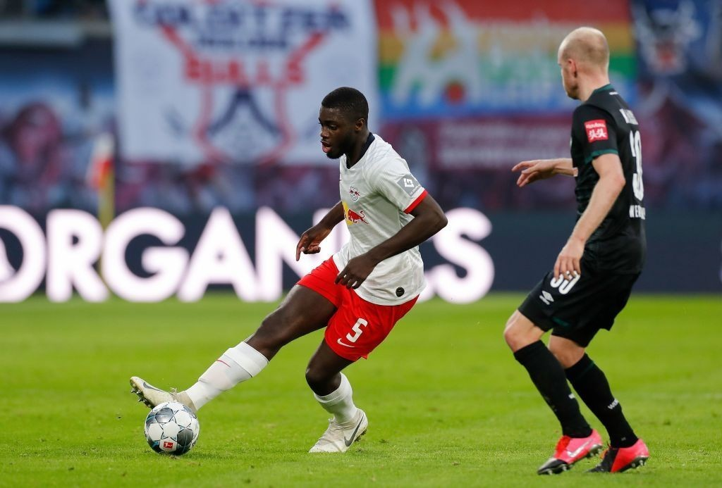 Leipzig's French defender Dayot Upamecano (L) and Bremen's Dutch defender Davy Klaassen vie for the ball during the German first division Bundesliga football match RB Leipzig vs SV Werder Bremen, in Leipzig, eastern Germany on February 15, 2020. (Photo by Odd ANDERSEN / AFP)