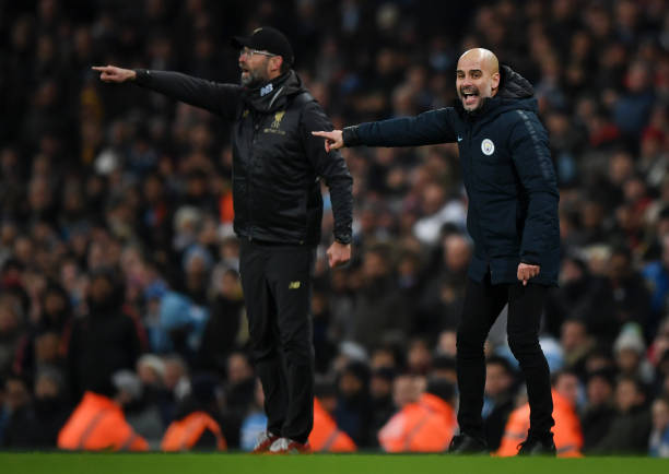 Josep Guardiola, Manager of Manchester City and Jurgen Klopp, Manager of Liverpool give their team instructions during the Premier League match between Manchester City and Liverpool FC at the Etihad Stadium on January 3, 2019 in Manchester, United Kingdom.