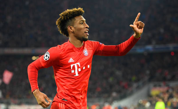 Kingsley Coman of FC Bayern Munich celebrates after scoring his team's first goal during the UEFA Champions League group B match between Bayern Muenchen and Tottenham Hotspur at Allianz Arena on December 11, 2019 in Munich, Germany.