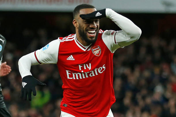 Arsenal's French striker Alexandre Lacazette celebrates after scoring their fourth goal during the English Premier League football match between Arsenal and Newcastle United at the Emirates Stadium in London on February 16, 2020. - Arsenal won the game 4-0.