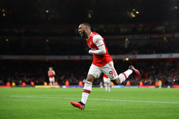 Alexandre Lacazette of Arsenal celebrates after scoring his sides fourth goal during the Premier League match between Arsenal FC and Newcastle United at Emirates Stadium on February 16, 2020 in London, United Kingdom.